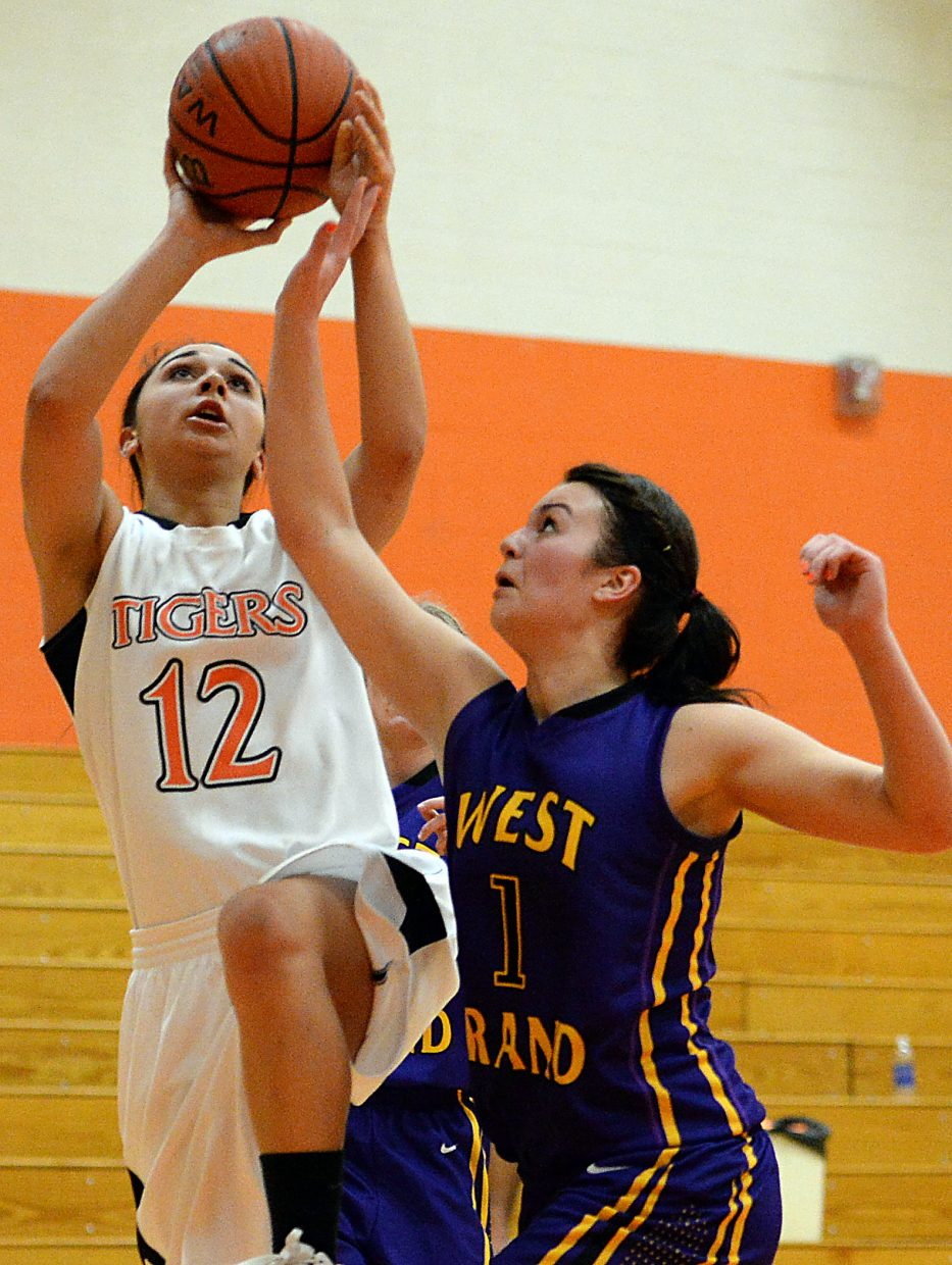 Laura Johnson goes up for a key late-game bucket Friday against West Grand.