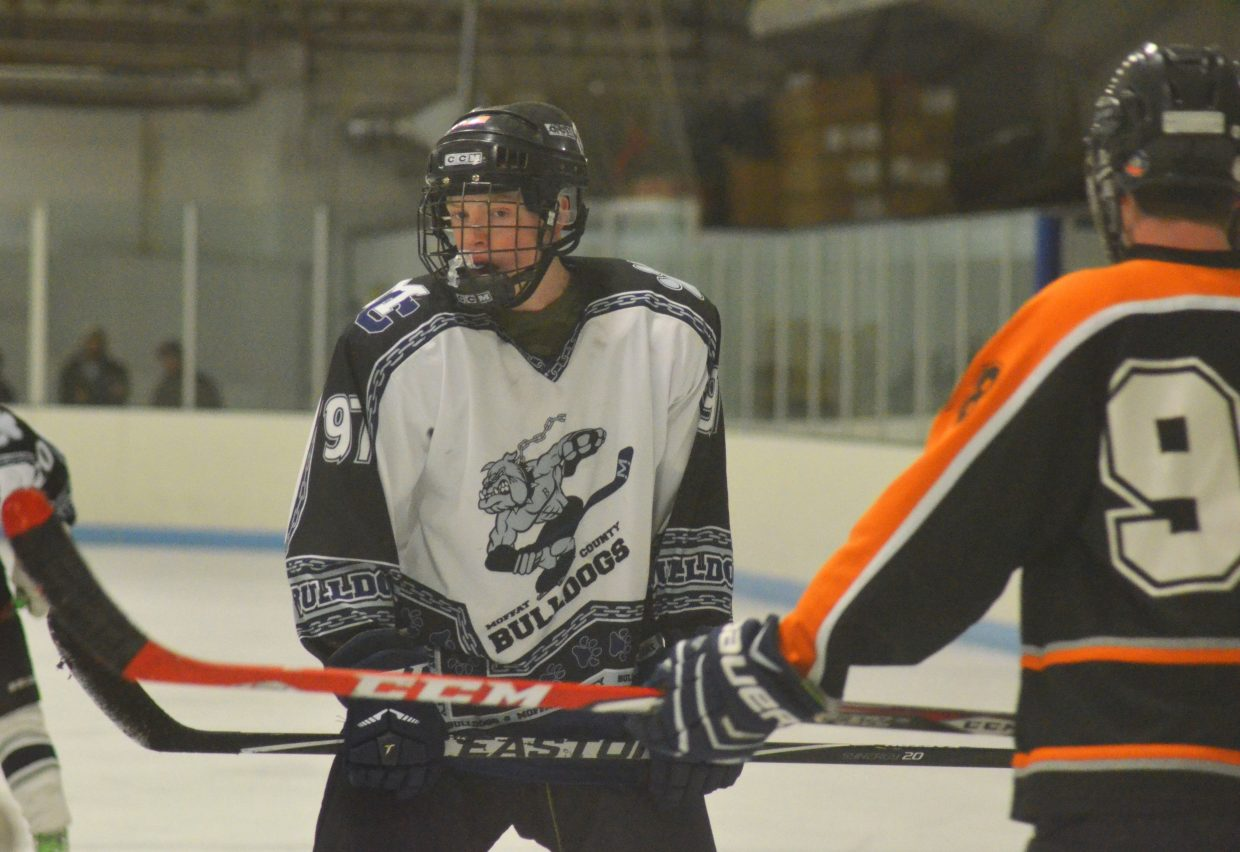 Wyatt Boatright readies for a faceoff during the Craig Youth Hockey Association 18U Midget team's first game with the Hyland Hills Jaguars. The Bulldogs lost their first game, 5-4, but came back, 8-4, in the next match Saturday night.
