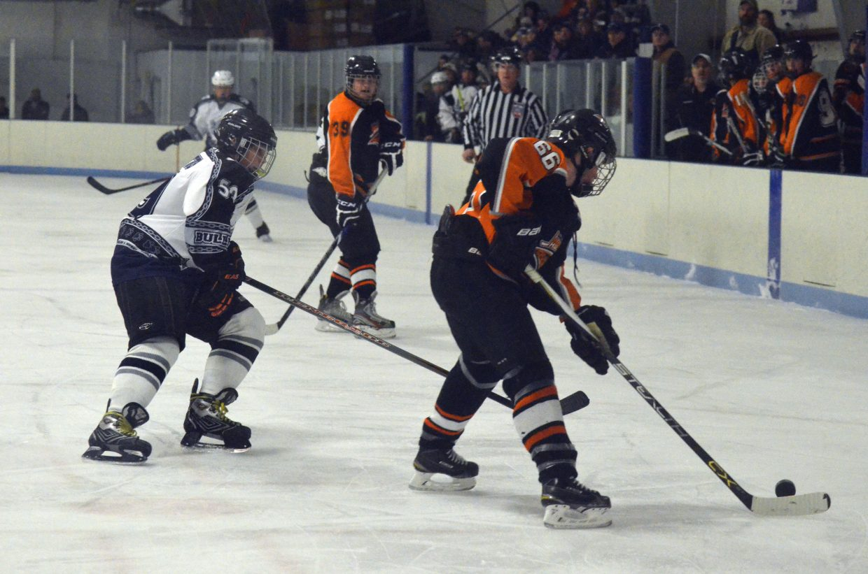 Craig hockey player Corbin Coutts gets back on defense as Hyland Hills assumes command of the puck during a game between the Moffat County Bulldogs and the Jaguars Saturday night.