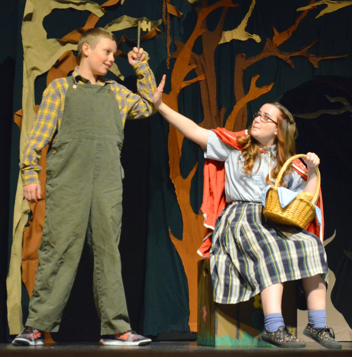 "A helpful locksmith (Ryan Peck) may have the key to the title character's (Courtney Smith) dilemma in ""Red Riding Hood."" The Missoula Children's Theatre production featured performances Saturday afternoon in the Moffat County High School auditorium that included dozens of local kids. Local support for the worldwide program was provided by Moffat County School District, The Memorial Hospital Foundation, Friends of Moffat County Education, Northwest Colorado Chapter of Parrotheads and Craig Kiwanis Club."
