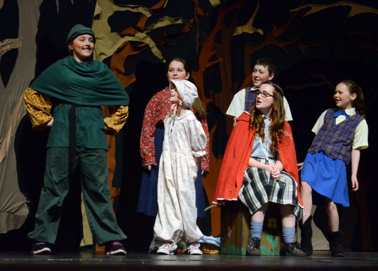 "From left, cousin Robin Hood (Kimber Roberts) is introduced to the Hood family including Baby Hood (Shelby Wilson), Mother Hood (Reina Steele), Brother Hood (Alexander Nichols), Red Riding Hood (Courtney Smith) and Sister Hood (Megan Neton) during ""Red Riding Hood"" by Missoula Children's Theatre."