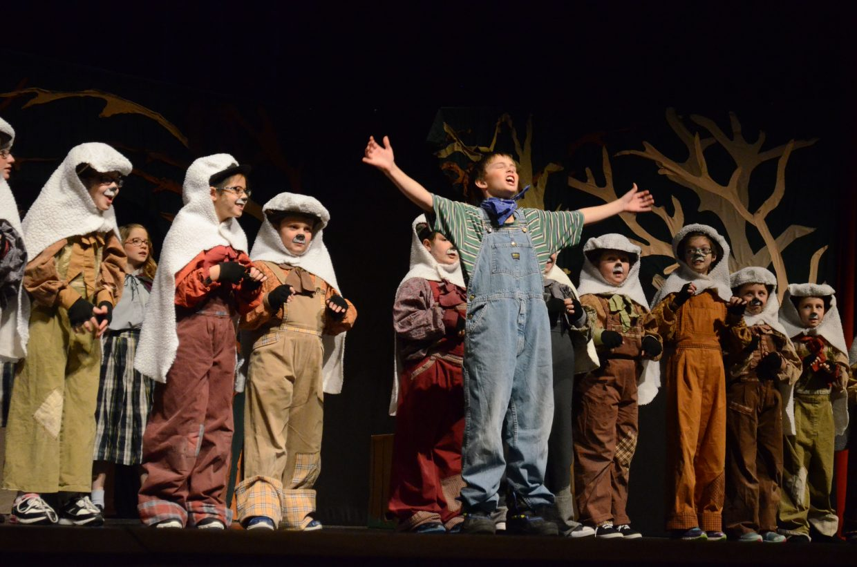 "The Boy Who Cried Wolf (Zachary Miller) fails to realize he's surrounded by wolves in sheep's clothing in ""Red Riding Hood"" by Missoula Children's Theatre."