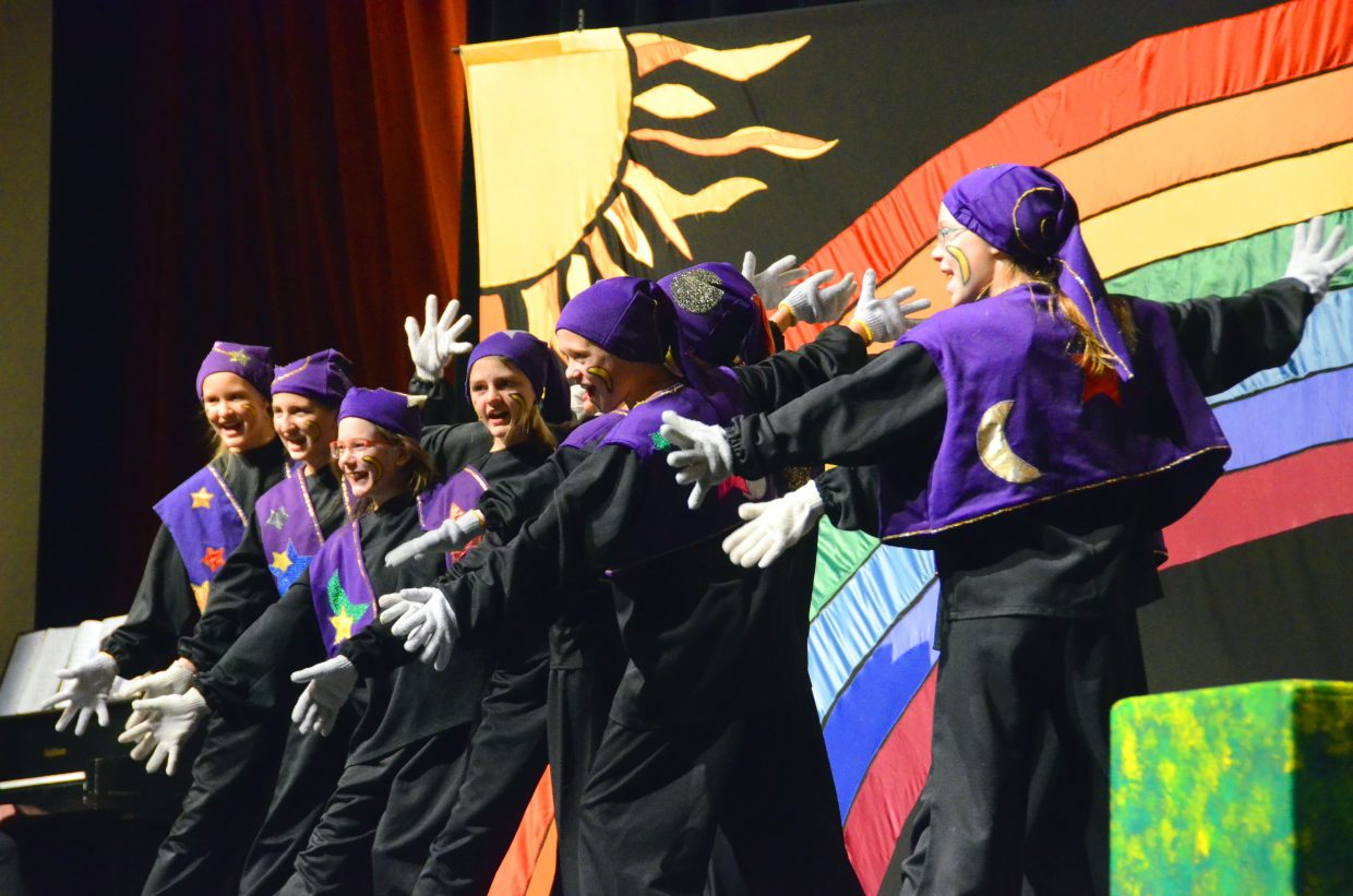 """The chorus of magicians helps set the scene through song and dance in the Missoula Children's Theatre production of """"The Wizard of Oz"""" Saturday afternoon in the Moffat County High School auditorium."""