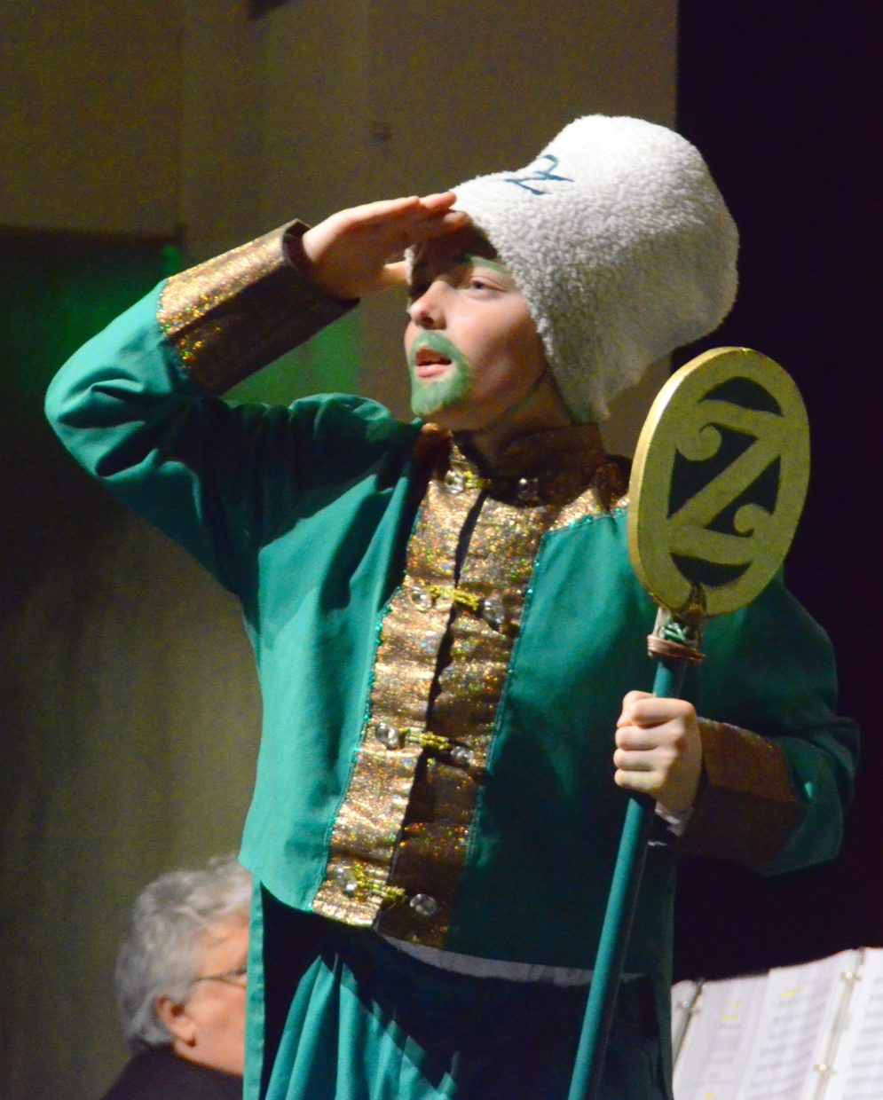 """The Green Guard (Logan Hafey) keeps a watchful eye at the gate of the Emerald City in the Missoula Children's Theatre production of """"The Wizard of Oz"""" Saturday afternoon in the Moffat County High School auditorium."""