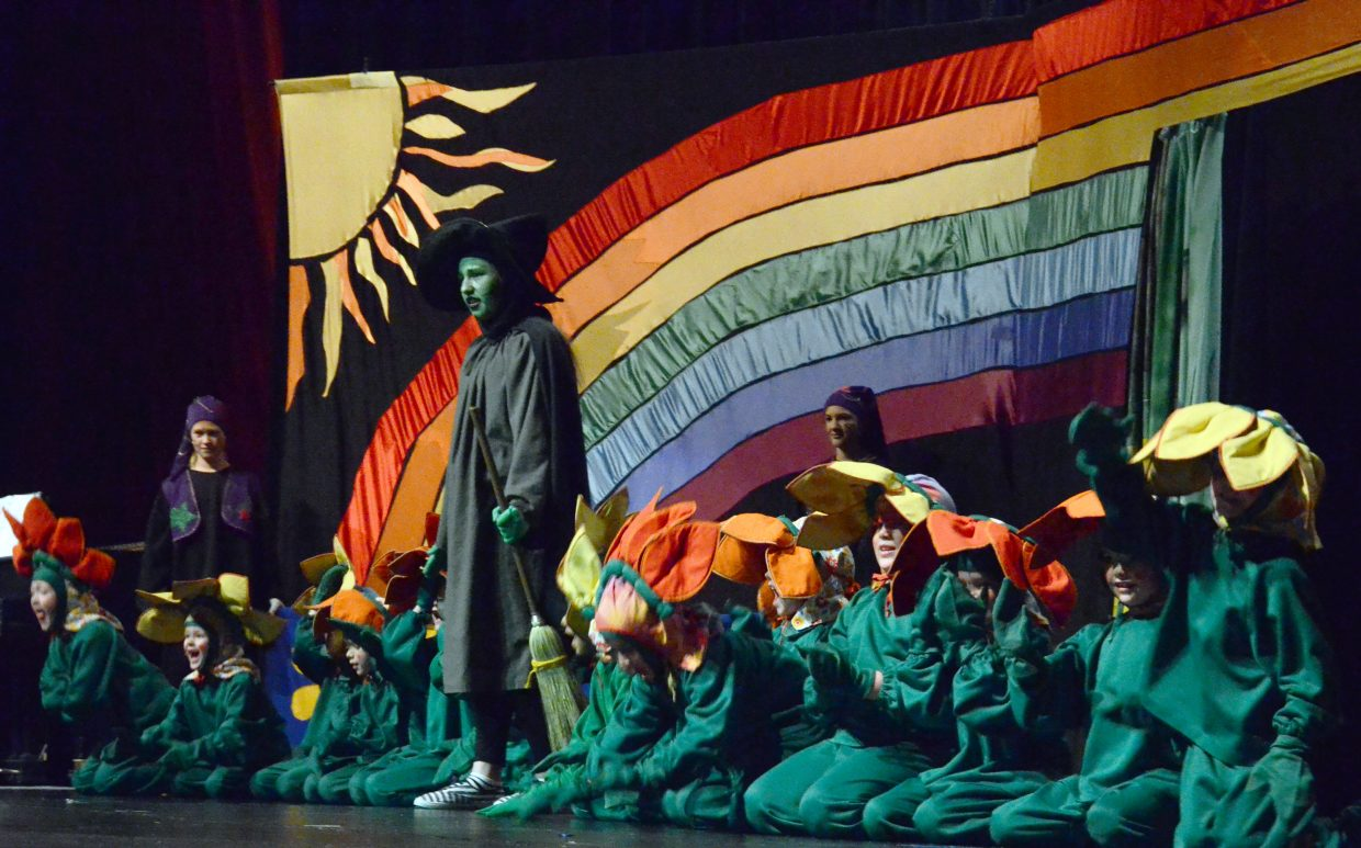 """The Wicked Witch of the West (Alexa Neton) casts a spell to create the Fierce and Ferocious Flowers in the Missoula Children's Theatre production of """"The Wizard of Oz"""" Saturday afternoon in the Moffat County High School auditorium."""