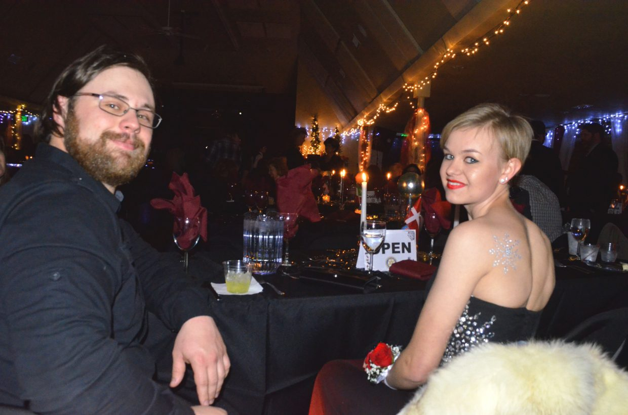 Chet Peterson and Faith Jones enjoy the festivities at Saturday's Diamonds & Spurs, hosted by Rotary Club of Craig. The annual formal event attracted more than 200 people to the Moffat County Fairgrounds Pavilion.