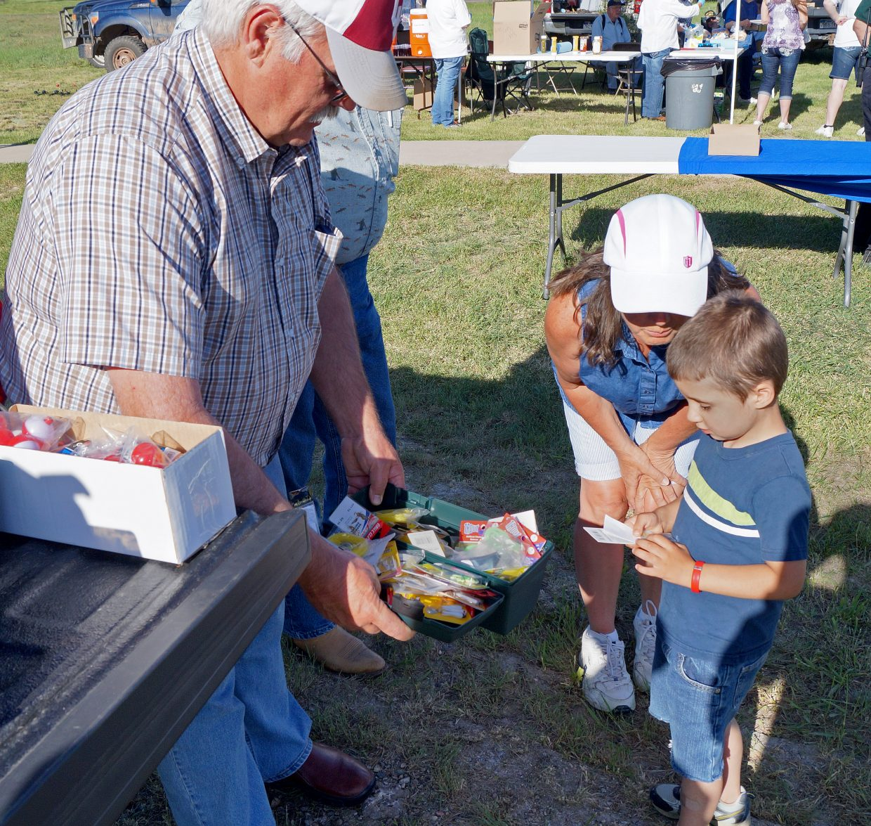 Luclas Slaight, 4, can't decide which prize to pick so Moffat County Sheriff KC Hume let him have two.