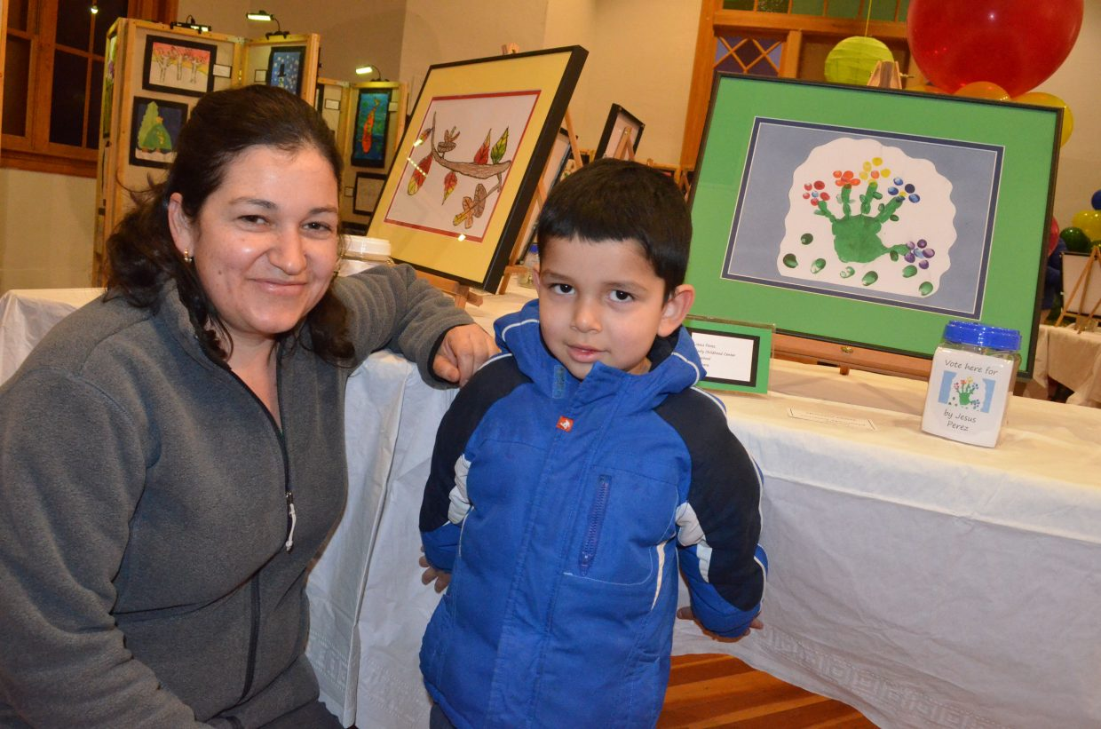 Early Childhood Center preschooler Jesus Perez, 3, and his mother, Leticia, exhibit his entry in the Cherish the Little Things Art Show. The top 20 selections included art pieces by students from nearly every elementary-level school in the area, including Sunset, Sandrock, East, Ridgeview and Calvary Baptist School.