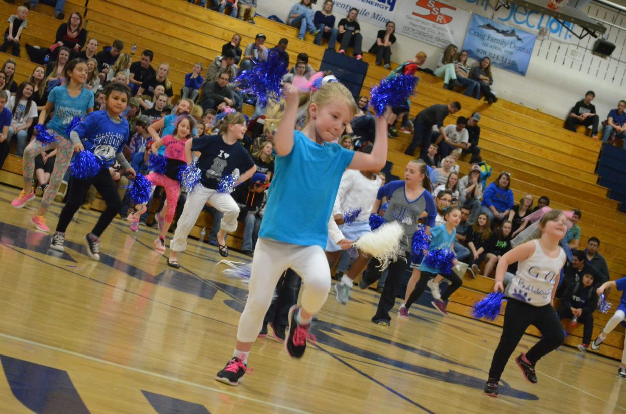 Members of the mini-cheer and dance team shake their pom-poms in support of the Bulldogs during halftime of the Moffat County High School boys varsity basketball game Friday night.
