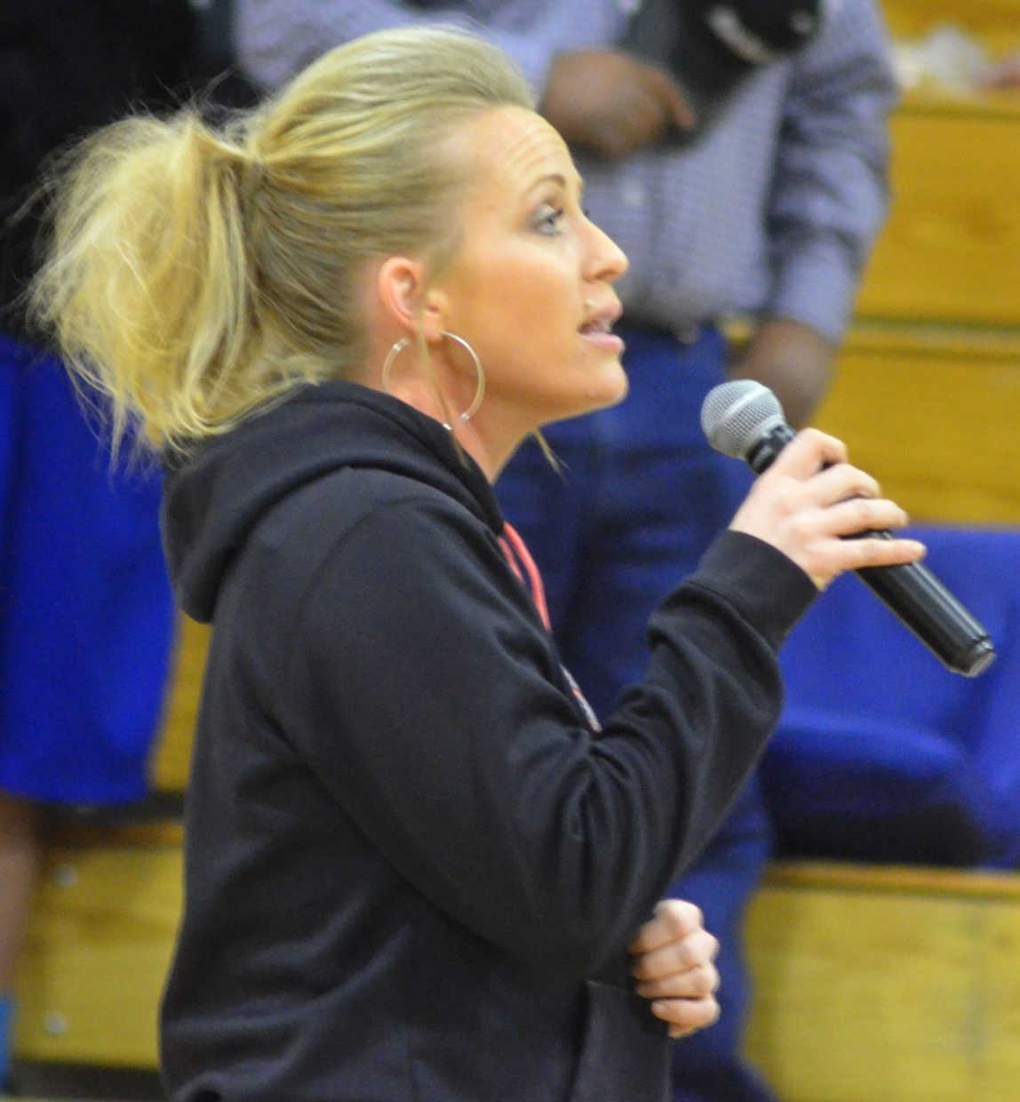 "Moffat County High School alumnus and volleyball coach Erin Knez sings ""The Star-Spangled Banner"" Friday night leading up to the girls varsity basketball game."