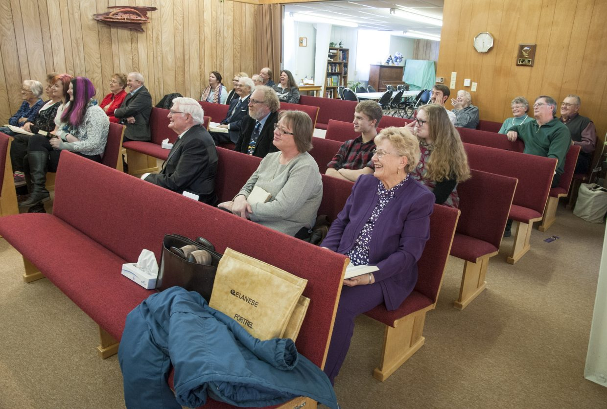 The congregation of Maybell Bible Church enjoys a good laugh at one of Pastor Linda Taylor's plentiful jokes. Taylor is known for her lively humor on Sunday mornings.