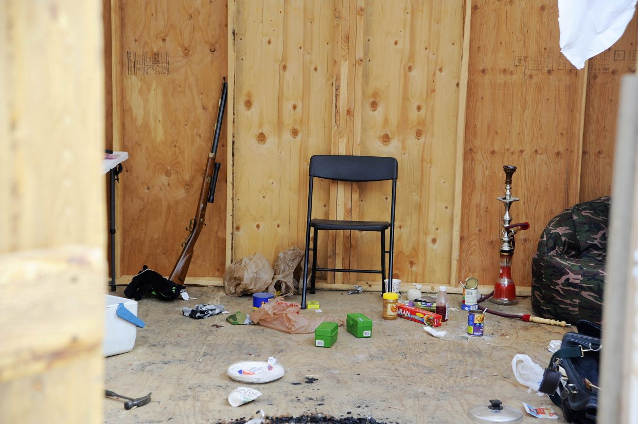 Deputies collected evidence, including a rifle, from inside the shack.