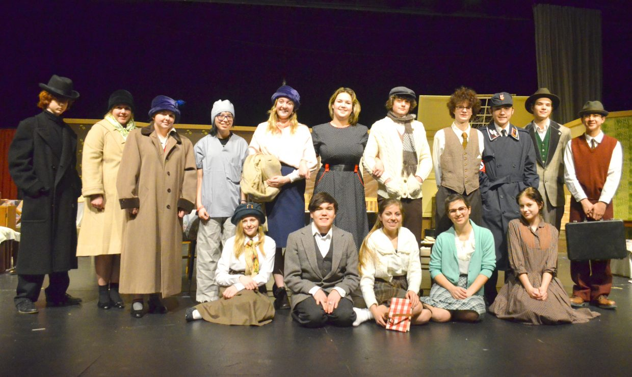 """The cast of """"The Diary of Anne Frank"""" gathers onstage in the Moffat County High School auditorium."""