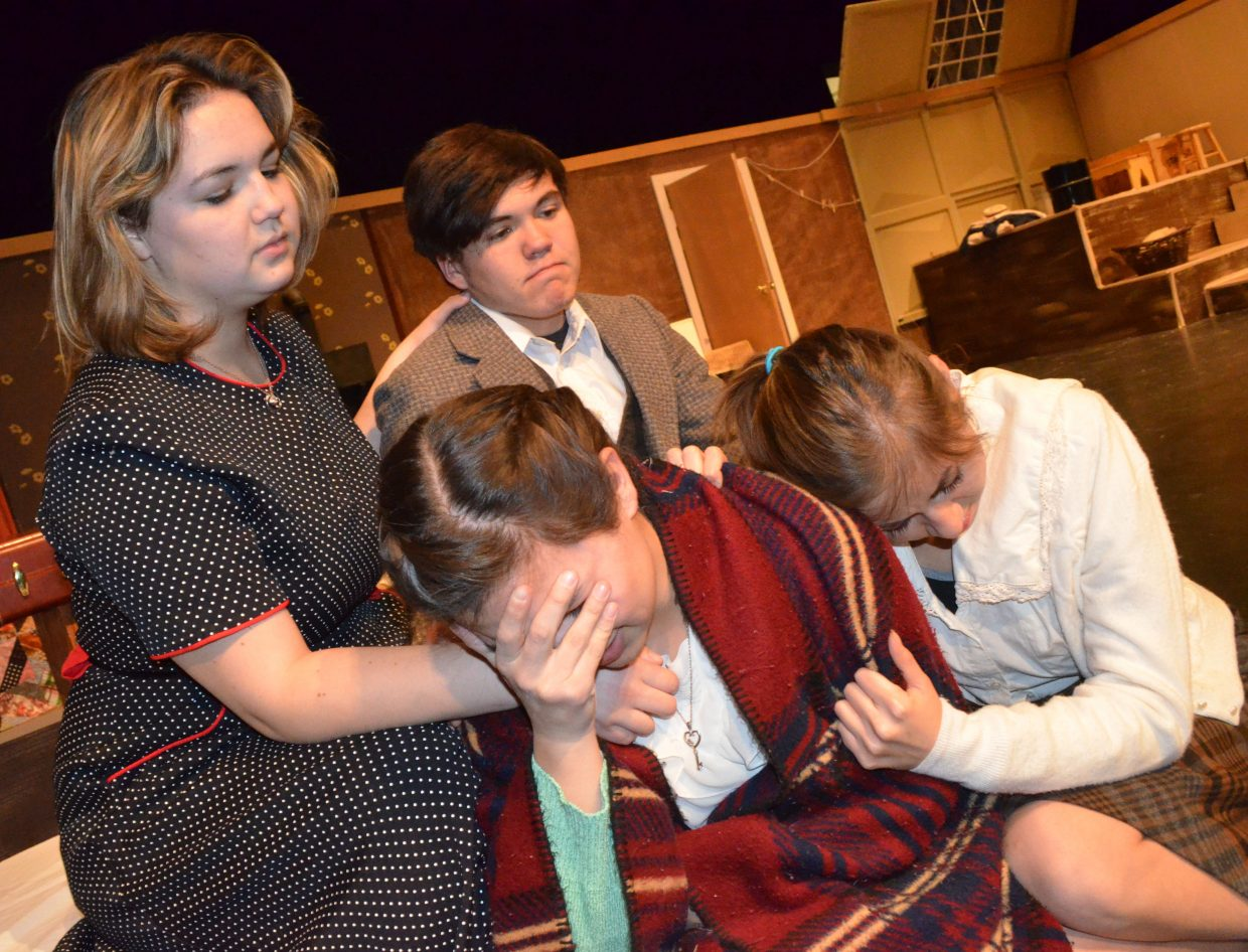 """The Frank family (clockwise, from top left, Christa Bird, Jake Stewart, Bekah Bird, Stephanie Duarte) comforts one another after nearly being discovered in """"The Diary of Anne Frank."""""""