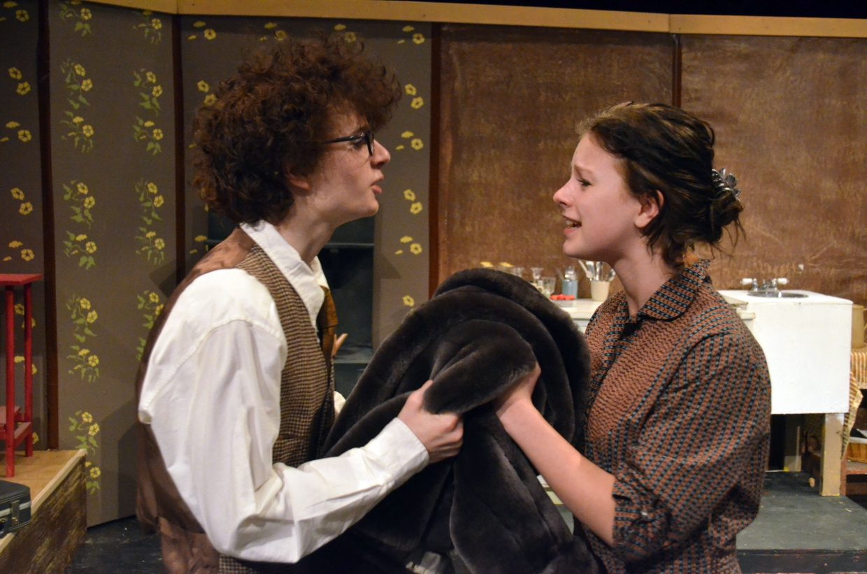 """The Van Daans (Jeremy Looper, Madelaine Petersen) argue over the necessity of a beloved family keepsake in """"The Diary of Anne Frank."""""""