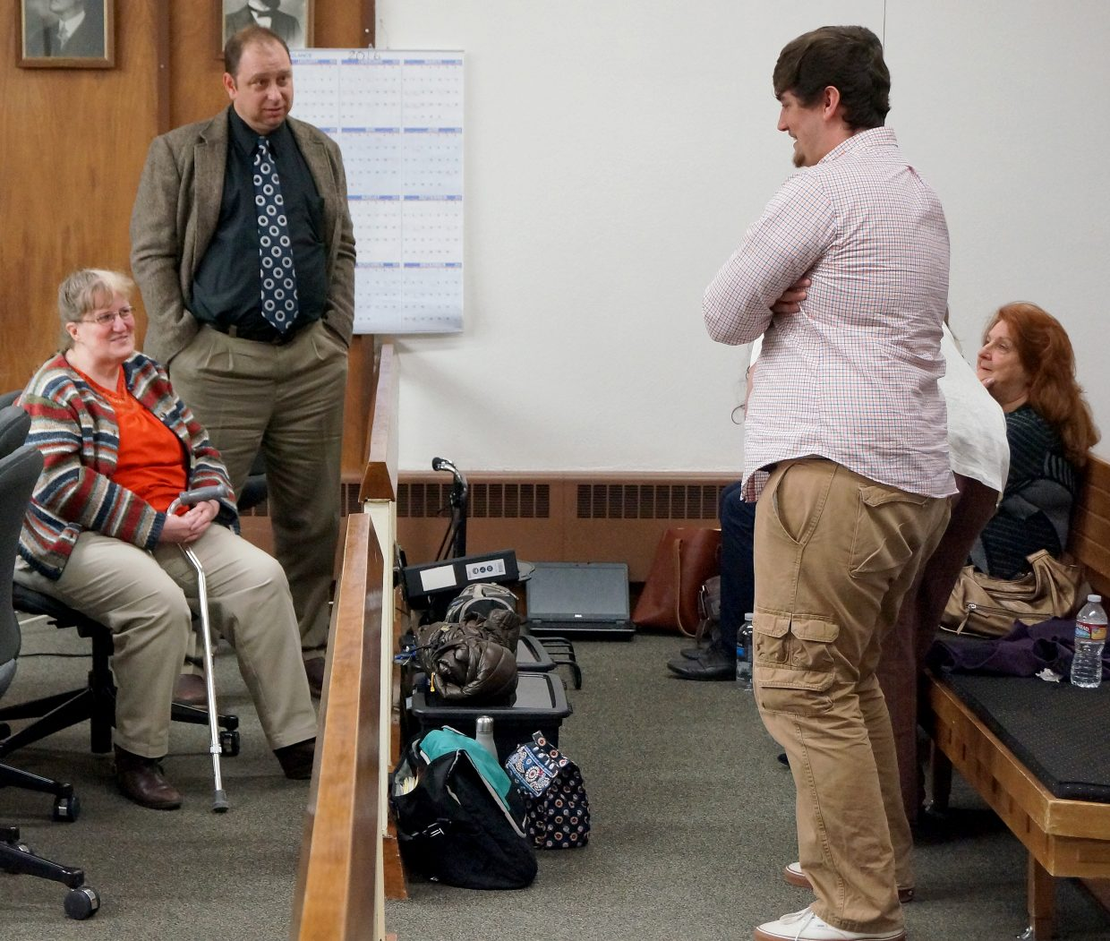 Georgie Hand speaks with her 19-year-old son, Rodney Galary, during a break in court,