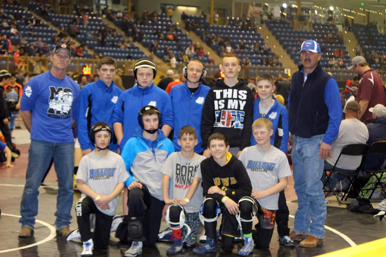 Craig wrestlers and coaches gather beside the mat following the Colorado Middle School State Championships in Denver. Craig placed 16th with competitors including Kaden Hixson, Brody Wiser, Caden Call, Dylan Zimmerman, Ryan Duzik, Anthony Duran, Joe Neal, Coltyn Terry, Michael Voloshin, Brock Hartung and Alex Reno.