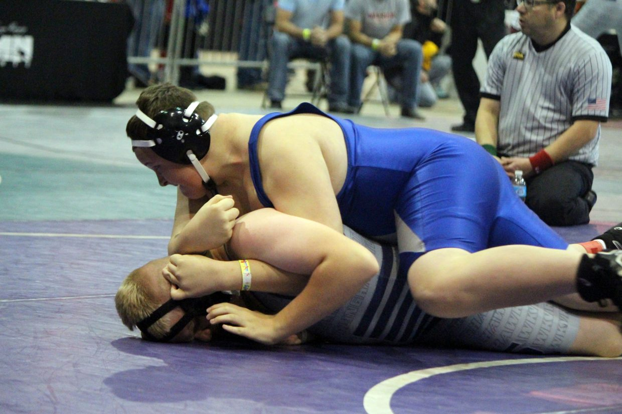 Craig Middle School's Alex Reno drives his opponent to the mat during the Colorado Middle School State Championships in Denver.