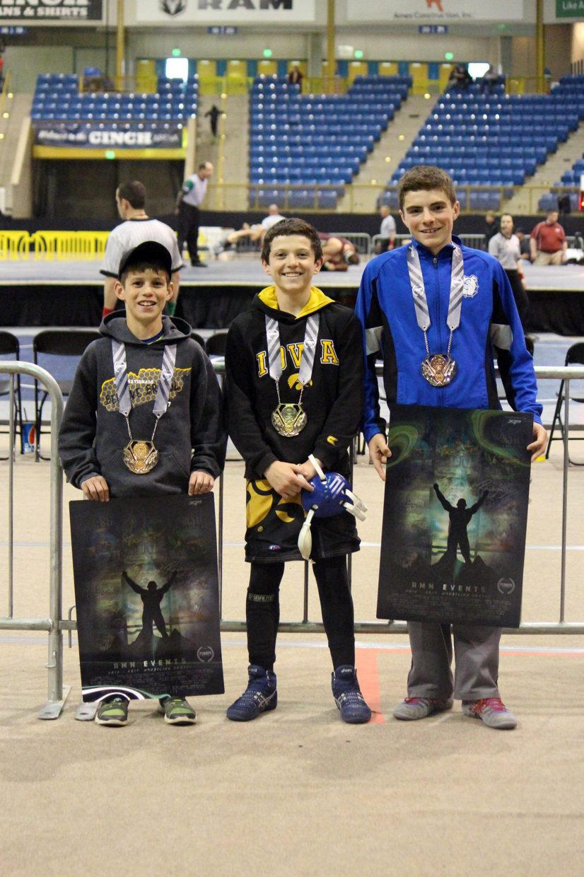 From left, Craig Middle School's Kaden Hixson, Dylan Zimmerman and Joe Neal hold up their honors following the Colorado Middle School State Championships in Denver. Hixson placed sixth in the 70-pound division, Zimmerman fifth at 90 and Neal sixth in 115.