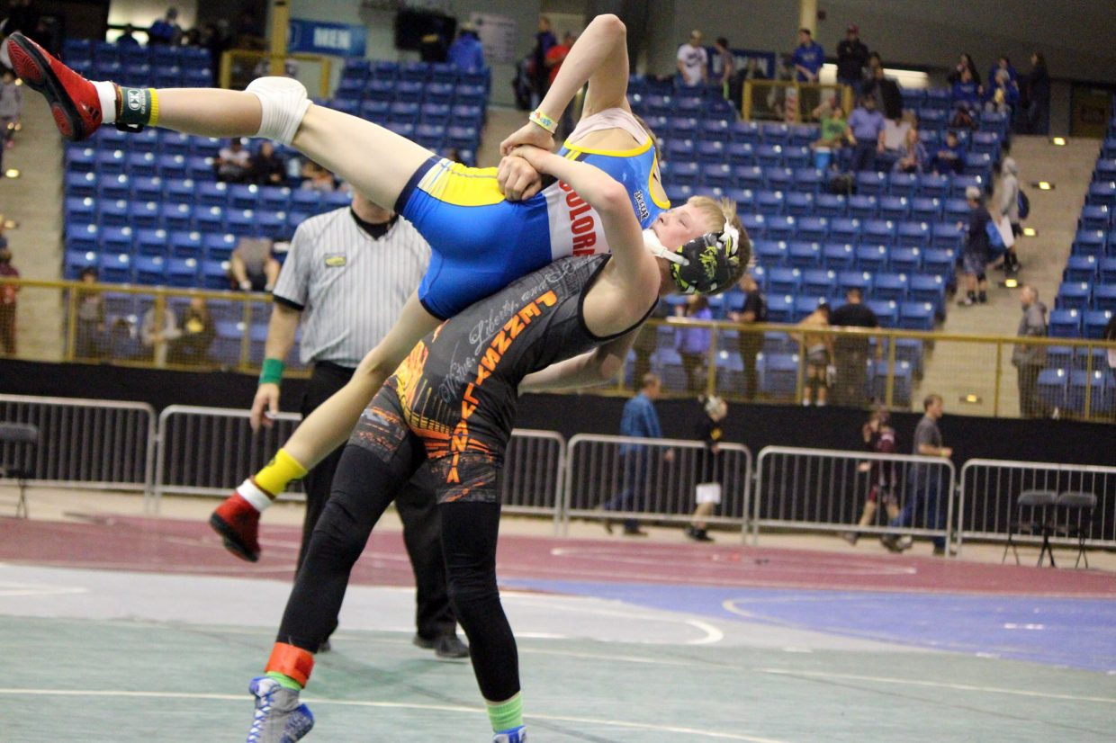 Craig Middle School wrestler Ryan Duzik elevates the competition during the Colorado Middle School State Championships in Denver.