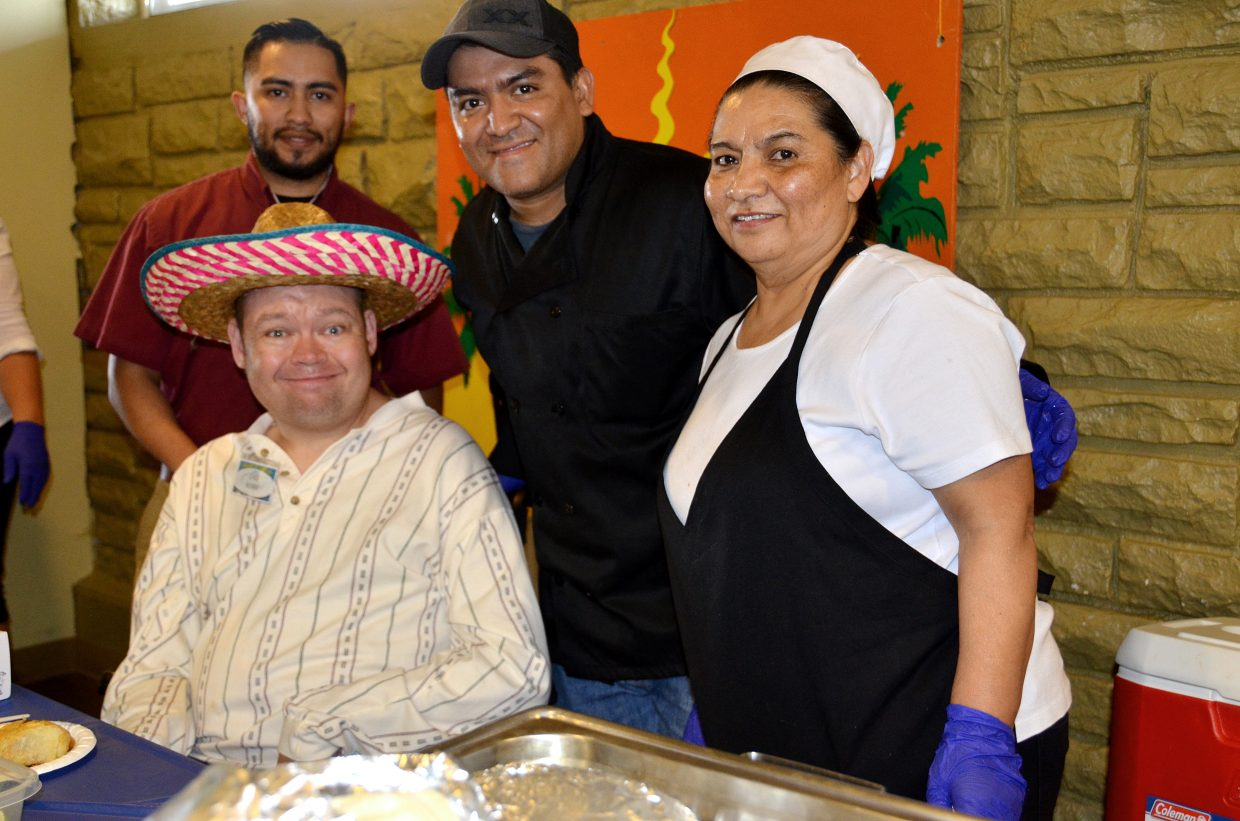 Vallartas won first place in Judges Choice at Horizons Specialized Services' annual Pick a Dish competition Thursday night in Craig. Restaurant owners Macho, left, and Roy Nunez stand behind Bobby Holmberg. Margarita Gomez also helped with the competition.