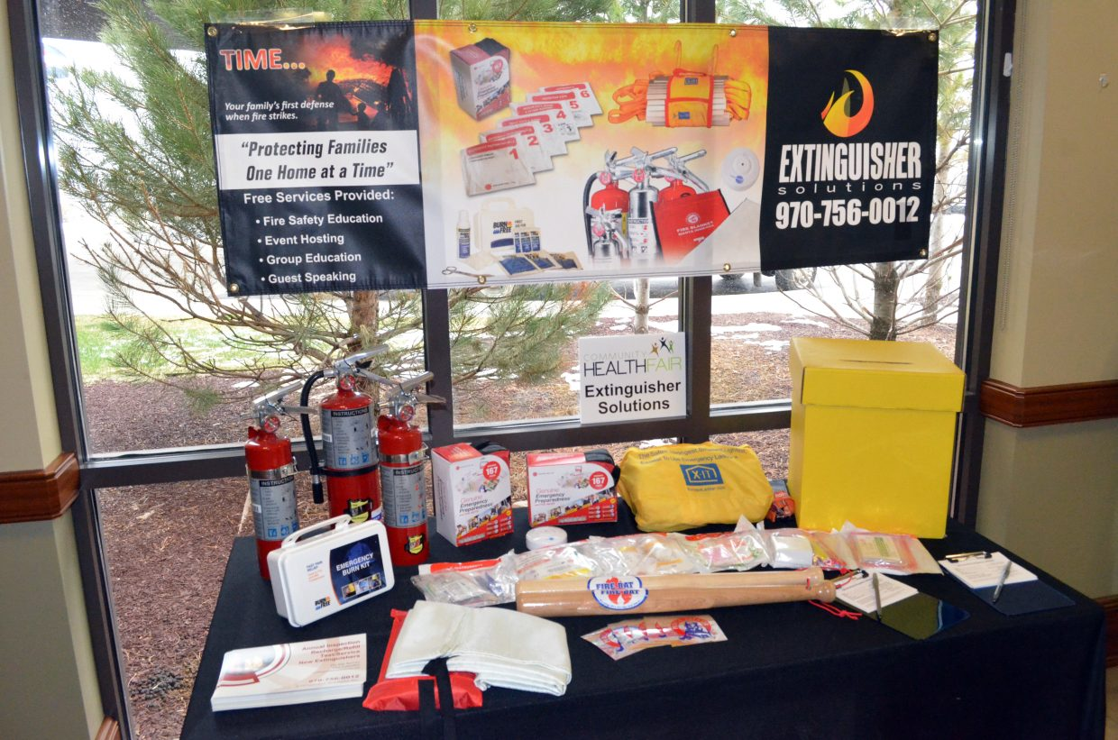 A booth containing fire safety materials displays the inventory of Extinguisher Solutions as part of The Memorial Hospital's annual health fair Saturday.