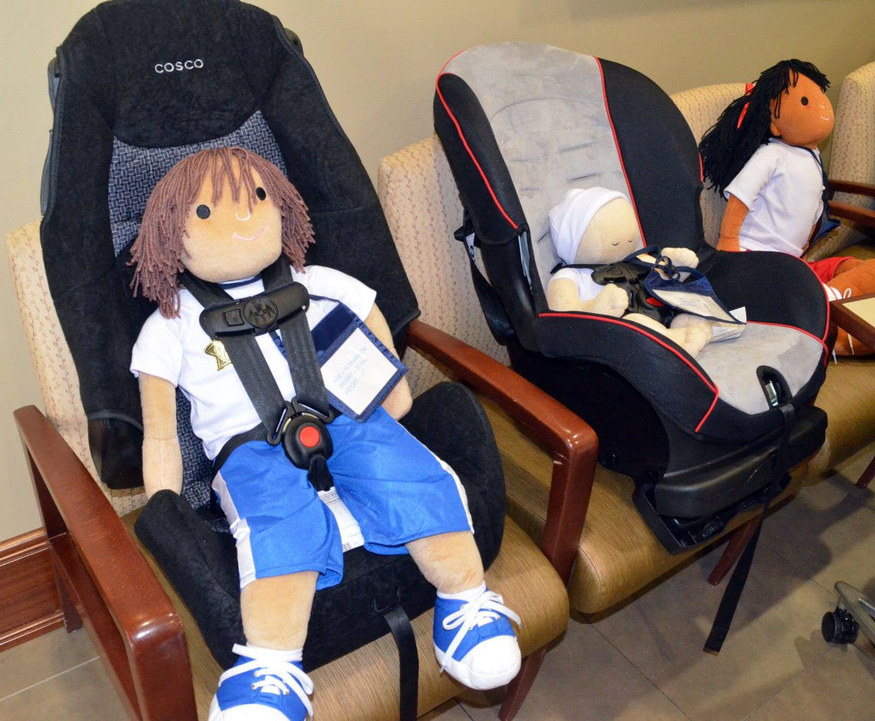 A display provided by Craig Police Department and Colorado State Patrol shows proper car seat usage for young children during The Memorial Hospital's annual health fair Saturday.