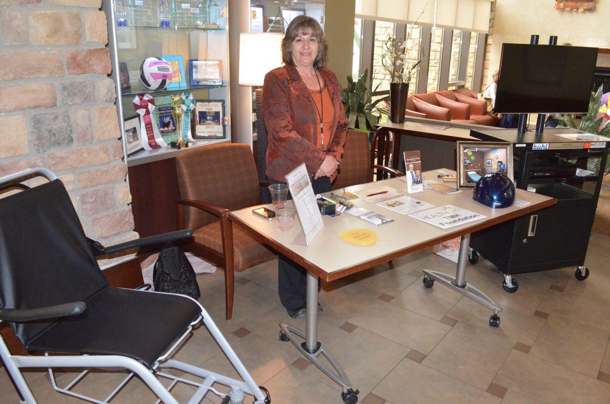 During The Memorial Hospital's annual health fair, Eva Peroulis displays the variety of recent projects put together recently by TMH Foundation, including donations of wheelchairs, an entertainment cart for patients, bicycle helmets and other ventures to enhance the hospital and the community.