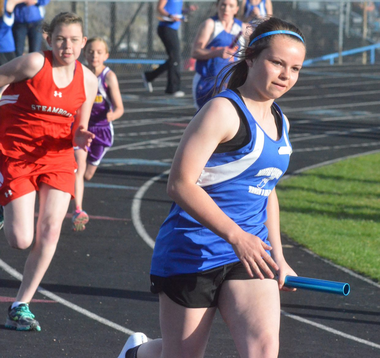Craig Middle School's Darbi Zimmerman rounds a corner during the Moffat County Night Relays.