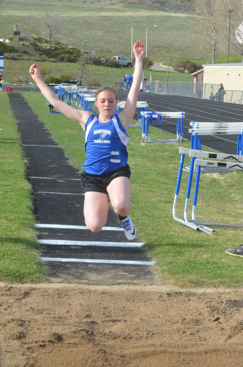 Craig Middle School's Megan Olinger gets some air during the long jump at the Moffat County Night Relays.