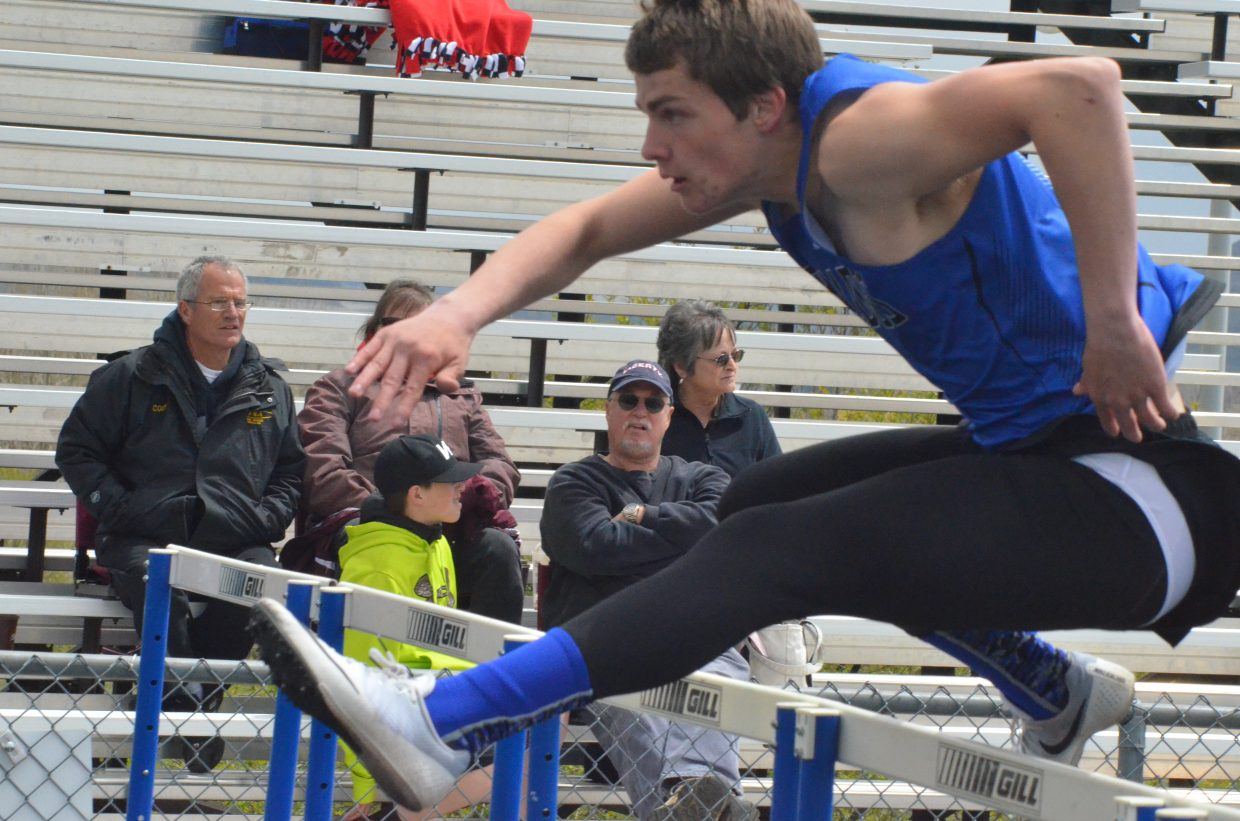Moffat County High School's Jared Atkin vaults during the boys 110-meter hurdles at Friday's Clint Wells Invitational in Craig. Atkin's win in the event was one of numerous victories for the Bulldogs.