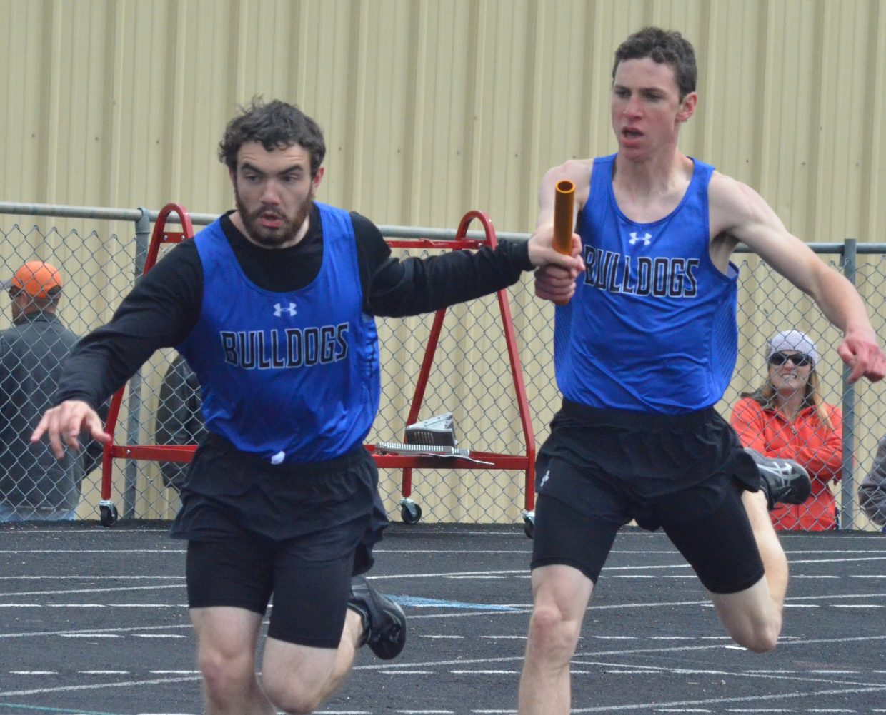 Moffat County High School's Isaac Trevenen, left, and Grant Wade complete a hand-off in the boys 4x200-meter relay at Friday's Clint Wells Invitational in Craig.