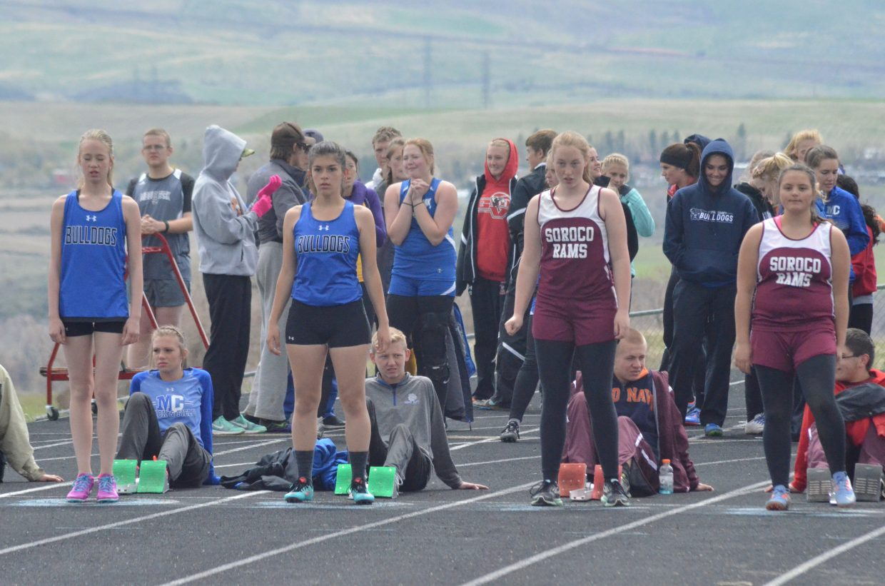 From left, Moffat County High School's Sara Beason and Alexis Main and Soroco's Hannah Hayes and Grace Beaty ready themselves at the starting line for the girls 100-meter dash at Friday's Clint Wells Invitational in Craig.
