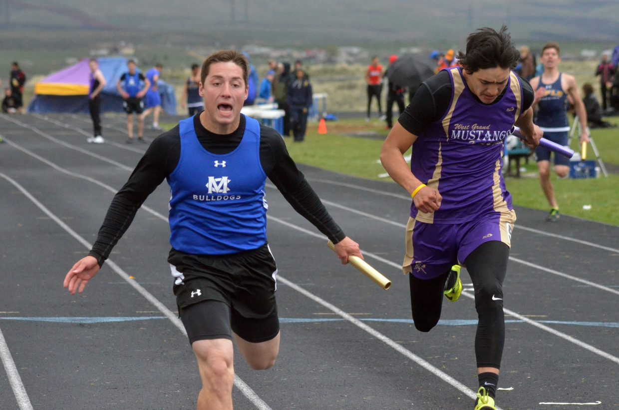 Moffat County High School's Eddie Smercina leans in to gain the advantage and the win in the 4x100-meter relay at Friday's Clint Wells Invitational at MCHS.