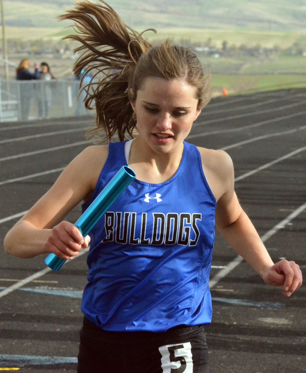Moffat County High School's Stephenie Swindler hones in on the finish line during the girls 4x400-meter relay at Friday's Clint Wells Invitational in Craig. MCHS girls placed second among teams.