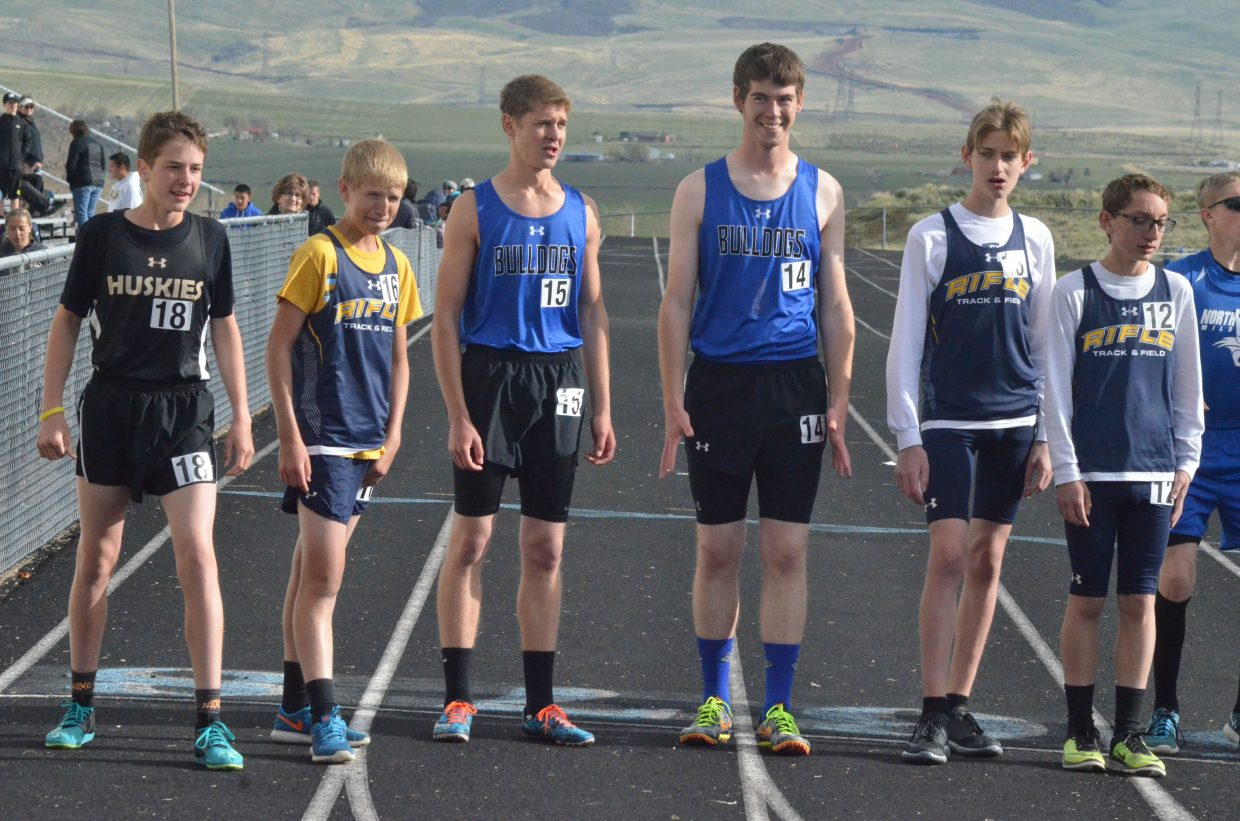 Moffat County High School's Garrett Flint and Nick Pugh prep for the start of the boys 3,200-meter run at Friday's Clint Wells Invitational in Craig.