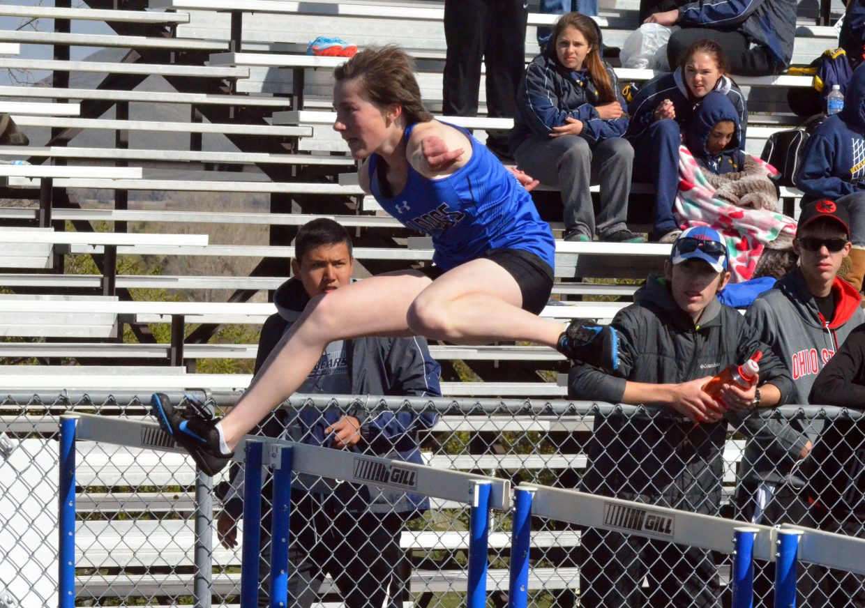 Moffat County High School's Allison Villard leaps with purpose during the girls 300-meter hurdles at Friday's Clint Wells Invitational in Craig.