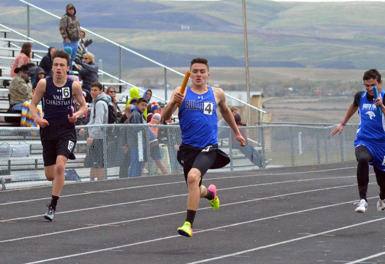 Moffat County High School's Victor Silva takes the lead on his way to a win in the boys 4x200-meter relay at Friday's Clint Wells Invitational in Craig.