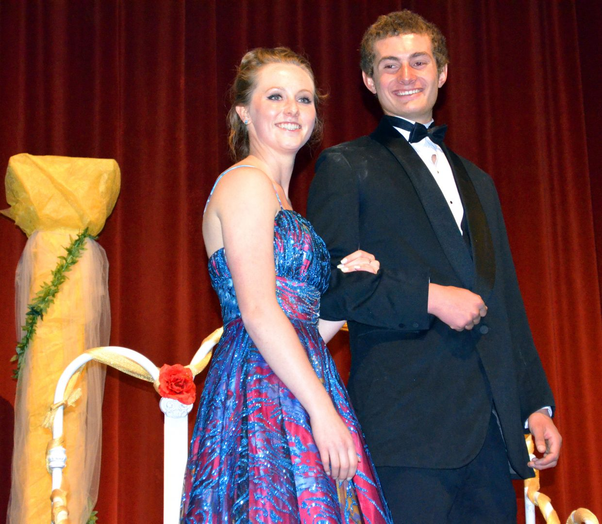 Moffat County High School's Kaylynn Haefs and Wyatt Bellio pose for pictures during the Grand March in the MCHS auditorium as part of Saturday night's prom.