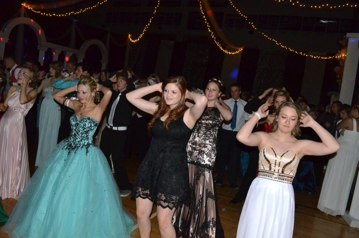 "Dancers attempt to stay in sync to ""Macarena"" during Moffat County High School's annual prom."