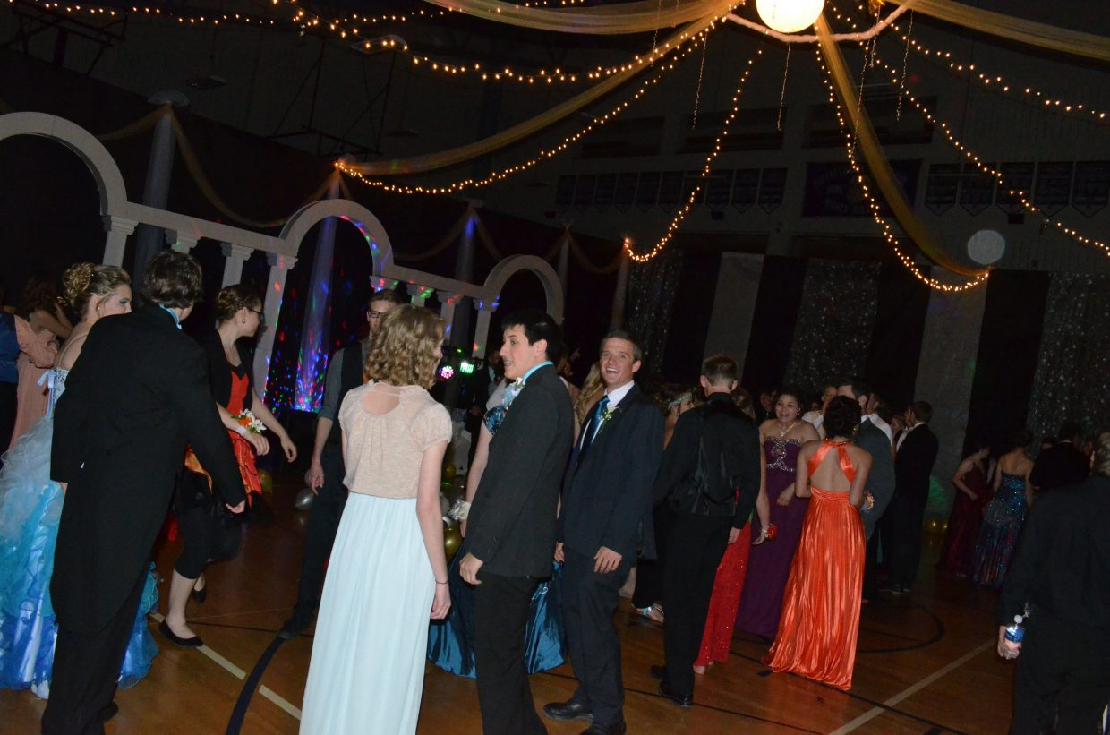 Students take to the dance floor during Moffat County High School's annual prom Saturday night. The theme was ancient Roman times with decorations including columns and reproductions of classic statues.