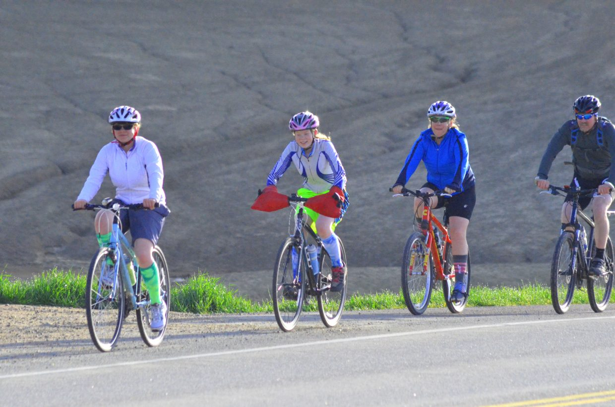 "Riders stick together during Saturday morning's ""Where the Hell's Maybell?"" excursion. More than 130 cyclists turned out for the 30th annual bike ride from Craig to Maybell put on by Craig Parks & Recreation."