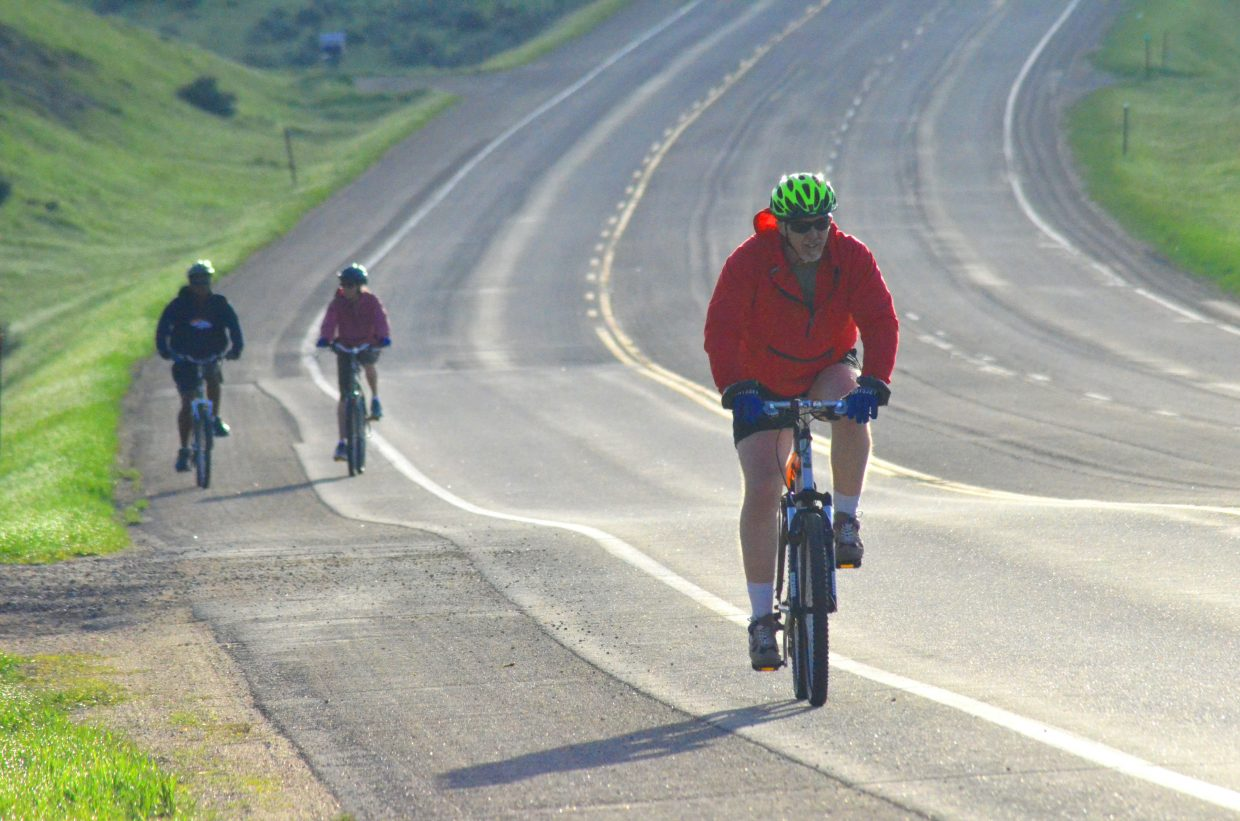 "Cyclists get in gear after completing a slope along US Highway 40 as part of Saturday morning's ""Where the Hell's Maybell?"""
