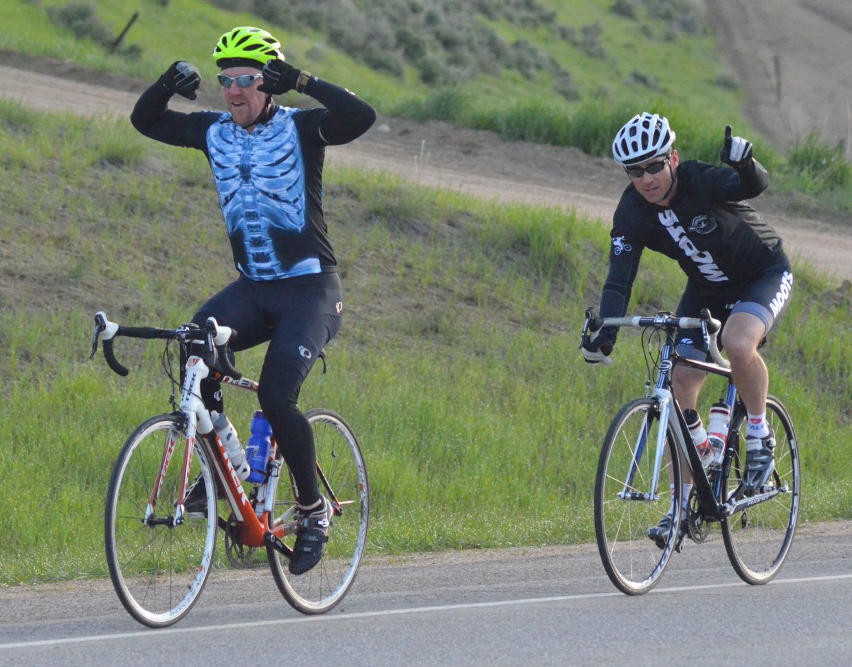 "Experienced cyclists show off for the camera while riding along US Highway 40 during Saturday morning's ""Where the Hell's Maybell?"""
