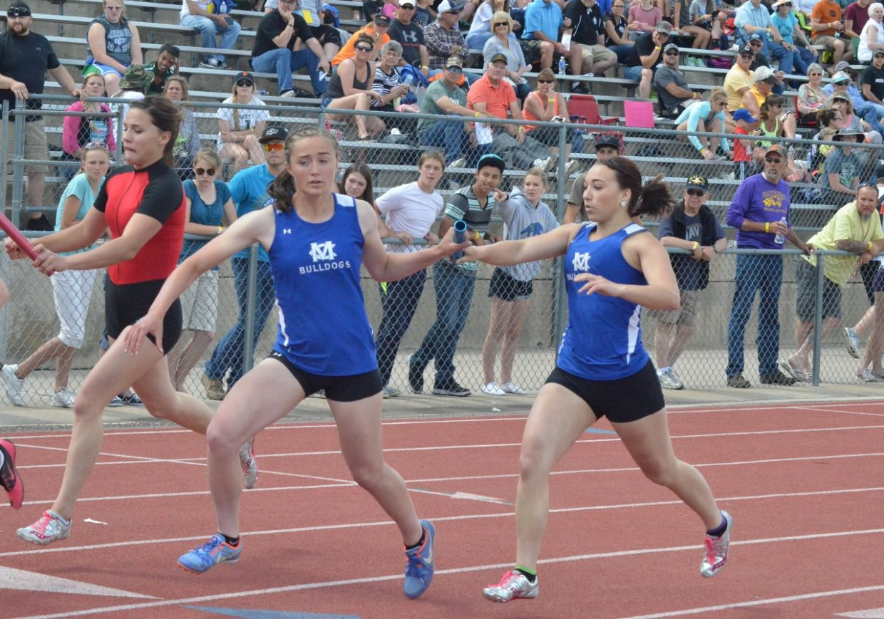 Moffat County High School's Josie Timmer, left, takes the hand-off from Quinn Pinnt in the Thursday preliminary round of the girls 4x200-meter relay during the State Track and Field Championships. The girls relay will compete in the finals Friday.