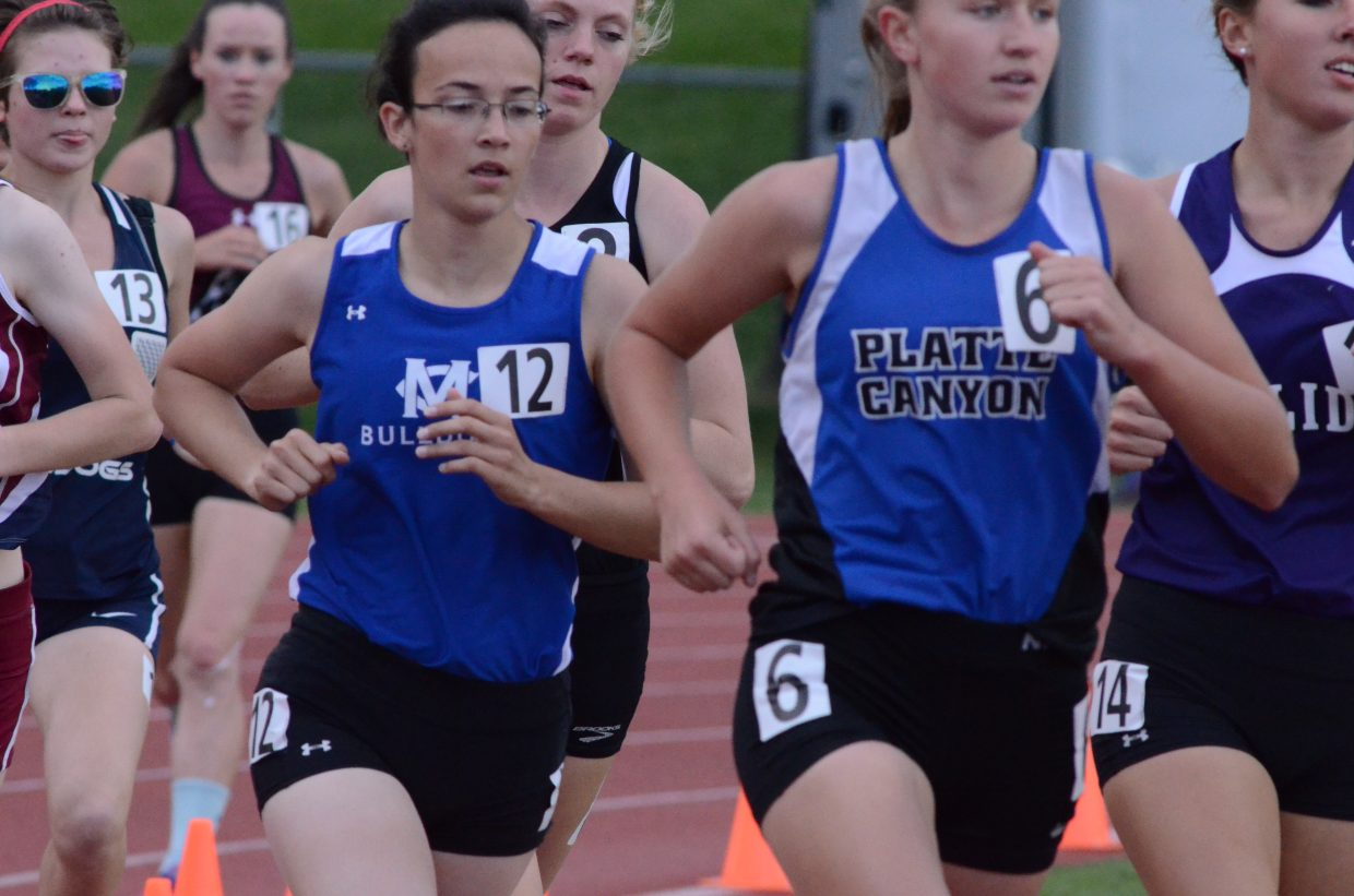 Moffat County High School's Emily Womble paces herself and seeks to move up among the pack of competitors during the 3,200-meter run of the State Track and Field Championships. Womble placed eighth in the race at this year's event, her third consecutive medal in the two-mile.