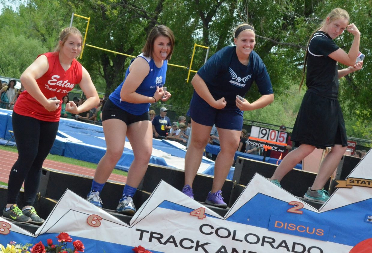 Moffat County High School's Charli Earle strikes a muscular pose on the podium of the 3A State Track and Field Championships. Earle placed sixth Friday in the girls discus.