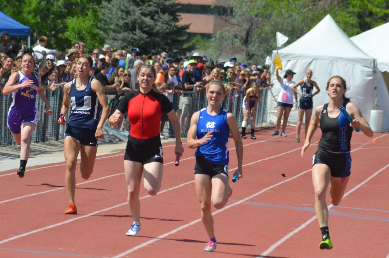 Moffat County High School's Kayla Pinnt speeds down the final stretch in the 4x100-meter relay, her last race of the State Track and Field Championships. In addition to winning the relay with teammates Emma Samuelson, Quinn Pinnt and Ary Shaffer, Kayla won the 100 and 200 dash, as well as winning and breaking a state meet record in the 400 dash.