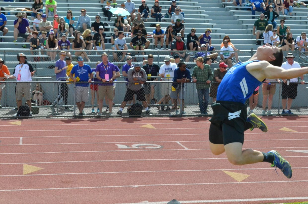 Moffat County High School coach Kip Hafey watches as long jumper Eddie Smercina gets some air in the long jump competition of the State Track and Field Championships. Smercina placed 15th.