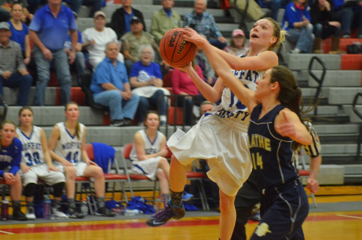 Moffat County High School's Kayla Pinnt works for a layup during the girls basketball district tournament. Pinnt is a nominee for Outstanding Female Athlete, competing in hoops, rodeo and track and field in her senior year.